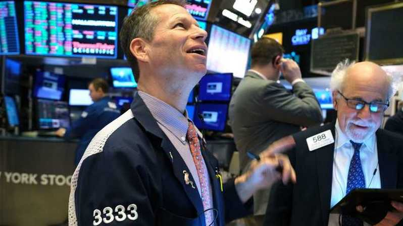 Ilustrasi bursa saham AS Wall Street. ( Foto: AFP )