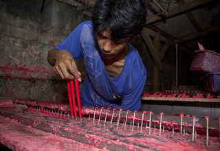 Molten wax is put into casts at a candle factory in Teluk Naga, Tangerang, on Wednesday (18/01) in preparation for Imlek, the Chinese New Year, next week. (JG Photo/Yudha Baskoro)