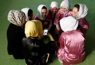Students of the Shaolin Wushu club chat before an exercise in Kabul, Afghanistan January 19, 2017. euters Photo/Mohammad Ismail