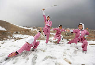 Hanifa Doosti (C), 17,  and other students of the Shaolin Wushu club show their Wushu skills to other students on a hilltop in Kabul, Afghanistan January 29, 2017. euters Photo/Mohammad Ismail