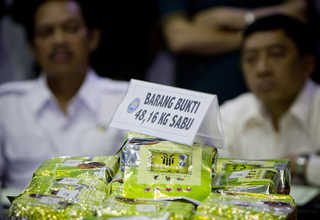 Officials display part of the 48.16 kilograms of crystal methamphetamine, 3,702 ecstasy tablets and 454 Happy Five tablets that were confiscated. (JG Photo/Yudha Baskoro)