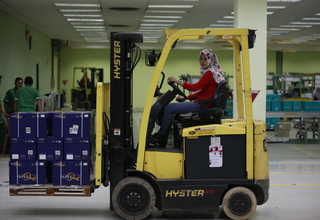 Lita has been driving a forklift for more than a year but, ironically, she still does not know how to drive a car. (Photo courtesy of RAPP/Reza Amirul Juniarshah)