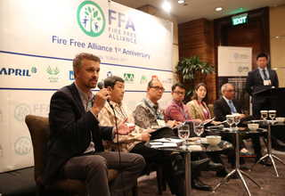Craig Tribolet, forest protection manager at APRIL, was explaining the company's community-focused prevention program to fight forest fire and haze. (Photo courtesy of RAPP)