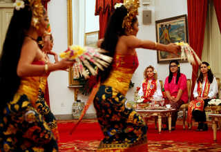 Pence's daughters, Charlotte, left, and Audrey, right, sit with Jokowi's daughter Kahiyang Ayu, center, as they watch a Balinese dance at the Presidential Palace. (Reuters Photo/Beawiharta)