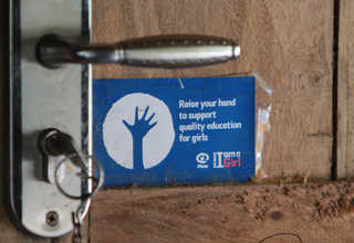 A child protection sticker on the door of a house in Menoro. (JG Photo/Yudhi Sukma Wijaya)