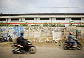 'A place where I was born, raised and forced to understand the harsh realities of life,' a graffiti says on a concrete fence in Bukit Duri. (JG Photo/Yudha Baskoro)