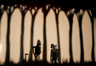 Maling Aguna or Aguna the Thief, right, meets a Muslim cleric in Eko Nugroho's new contemporary 'wayang bocor' shadow puppet play, 'Semelah.' or 'In the Name of God.' (JG Photo/Yudha Baskoro)