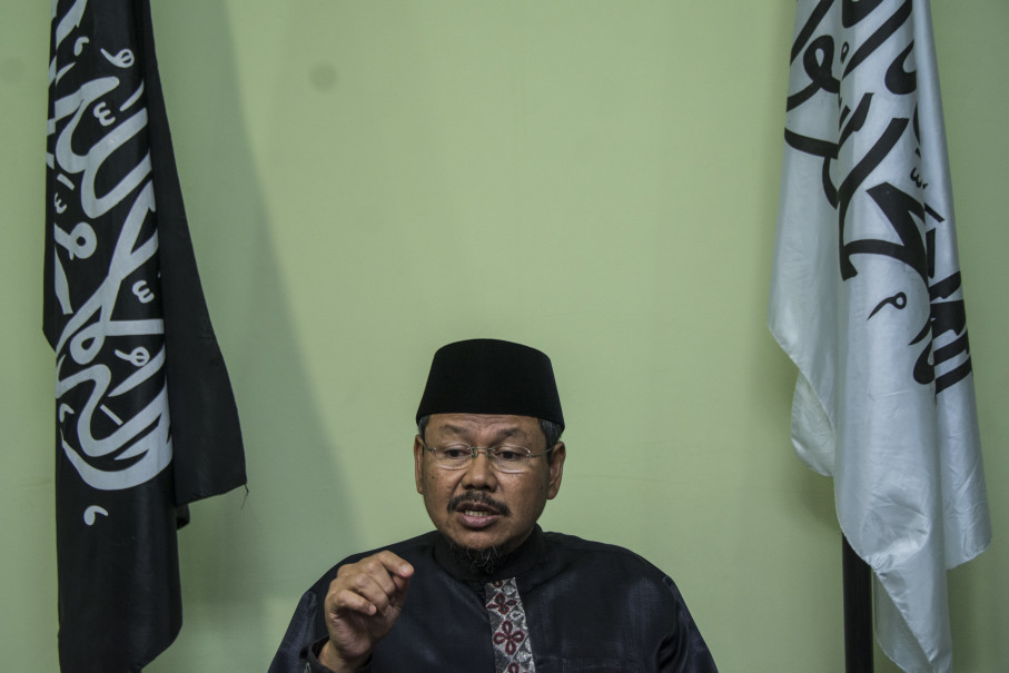 Muhammad Ismail Yusanto, one of the group's most influential figures, who manages its public communication was talking to reporters on May 8, regarding the government's decision to dismantle the organization. (Antara Photo/Aprilio Akbar)