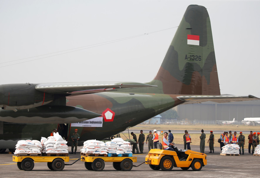 More sacks of rice are being loaded into an Indonesian Air Force Hercules C130 transport plane. (Reuters Photo/Beawiharta)