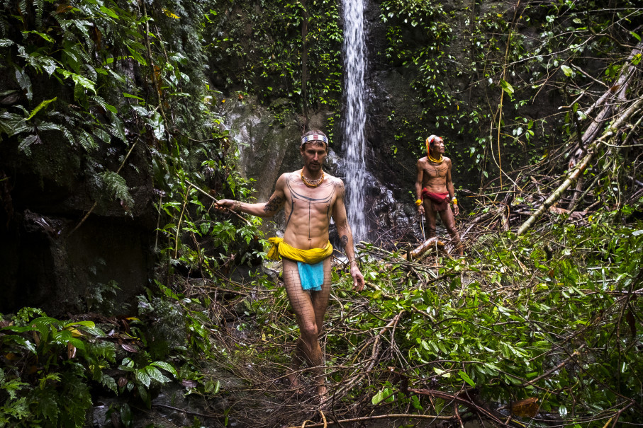 Rob Henry, Australian surfer and filmmaker, pictured in the jungle regions of Siberut Island in Mentawai with Sikerei Masit Dere. (Photo courtesy of Chris Hopkins)