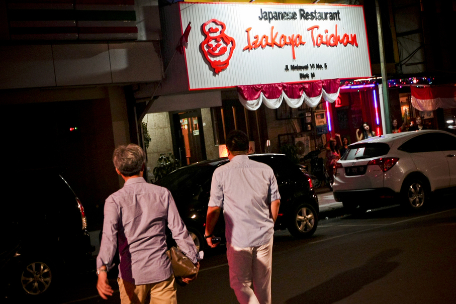 Japanese salarymen stumble out of a karaoke bar in Blok M. (JG Photo/Yudha Baskoro)