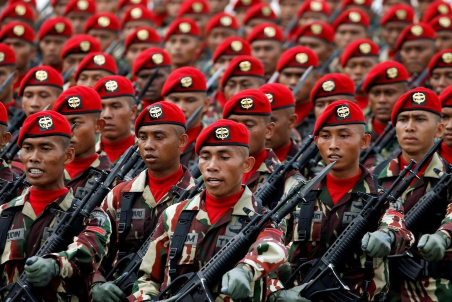 Members of Kopassus, the TNI's special forces, march during the event. (Reuters Photo/Beawiharta)
