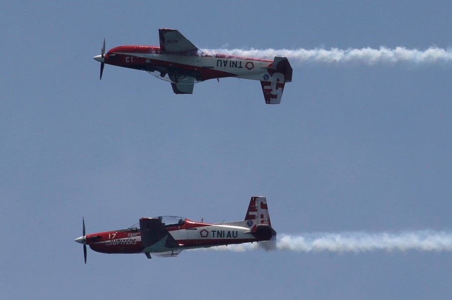 Members of the Indonesian Air Force's aerobatic team perform during the celebrations. (Reuters Photo/Beawiharta)