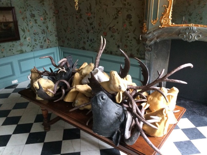 Photo 2: Replica of animal hunting trophies made from wax on displayed at Oude Kerk Church in Amsterdam. The wax sculptures are made by Indonesian artist Iswanto Hartono for his exhibition of the Dutch colonial history in Indonesia. This exhibition is a part of the biannual Europalia Arts Festival which will officially starts on October, 10. (Photo courtesy of Iswanto Hartono, an independent photographer)