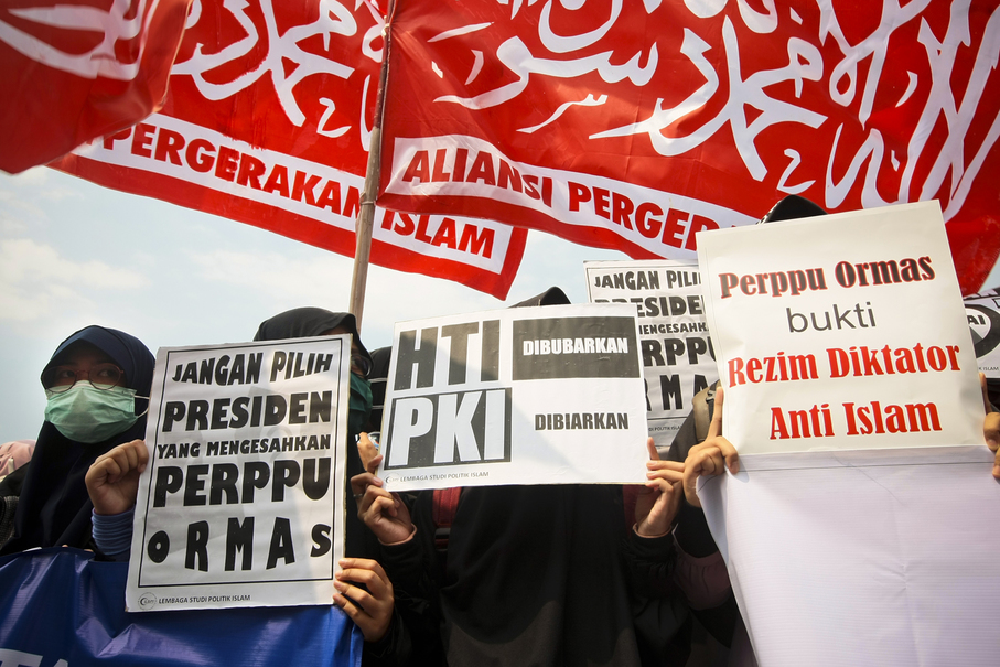 'Perppu Ormas is Proof of an Anti-Islam Dictator,' one sign says during Friday's demonstration. (JG Photo/Yudha Baskoro)