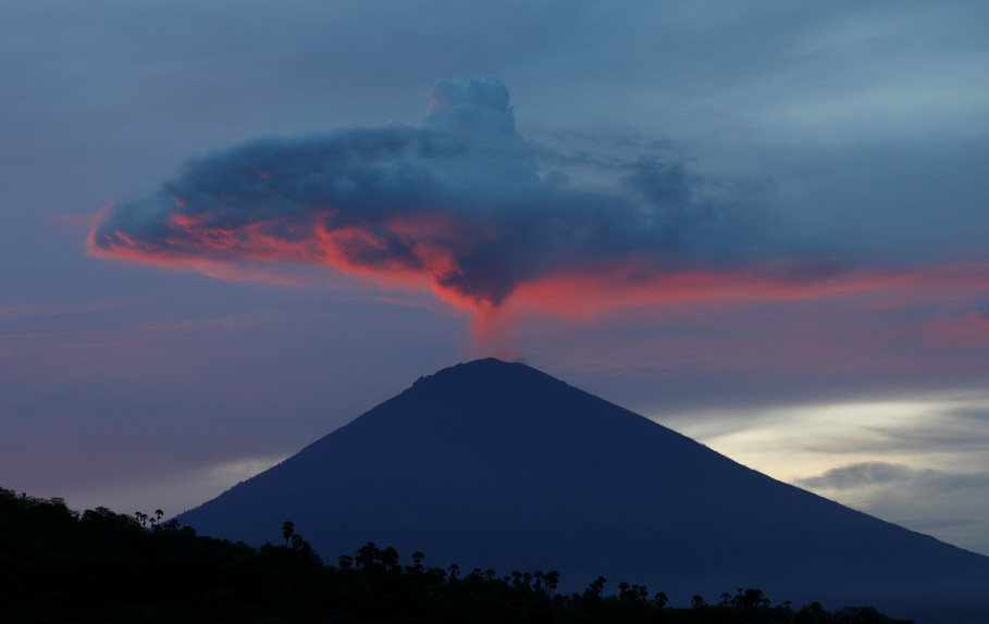 A plume of smoke above Mount Agung volcano is illuminated at sunset as seen from Amed. (Reuters Photo/Darren Whiteside)