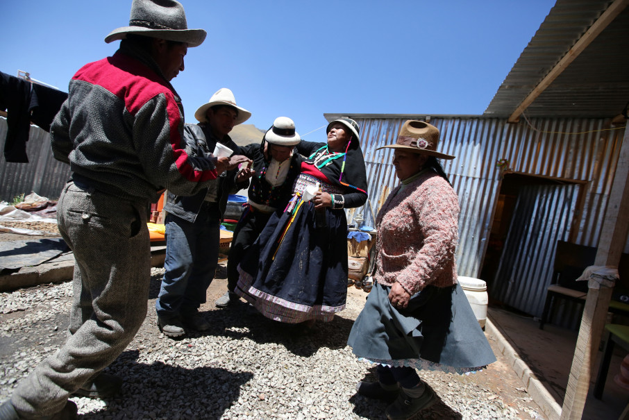 Monica Lima (2nd R) and friends gather at her house days after her wedding in the town of Nueva Fuerabamba in Apurimac, Peru, October 3, 2017. Reuters Photo/Mariana Bazo