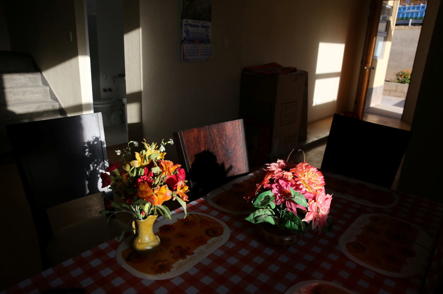 """Flowers are displayed in the home of Cipriano Lima in the town of Nueva Fuerabamba in Apurimac, Peru, October 2, 2017. Reuters Photo/Mariana Bazo  SEARCH """"BAZO FUERABAMBA"""" FOR THIS STORY. SEARCH """"WIDER IMAGE"""" FOR ALL STORIES."""