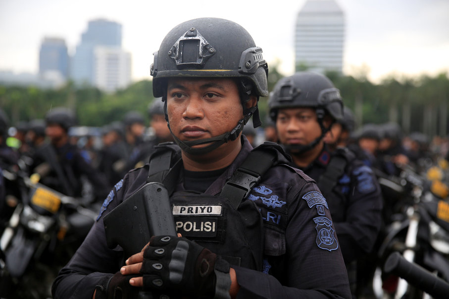 Mobile brigade policemen stand during a ceremony ahead of Christmas and New Year's celebrations in Jakarta on Dec. 21, 2017. (Reuters Photo/Beawiharta)