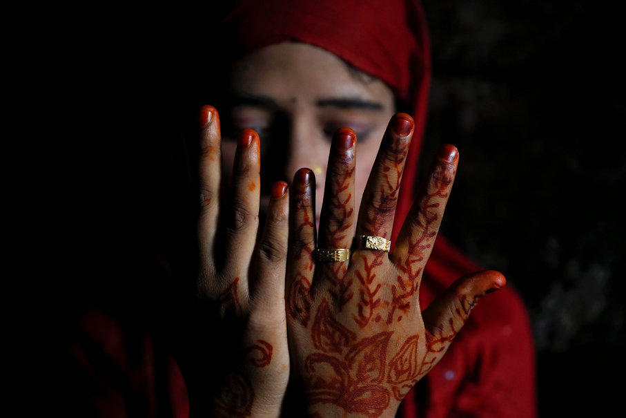 Shofika Begum, 18, shows decoration on her hands on the day she marries Saddam Hussein, 23, both Rohingya refugees, at the Kutupalong camp near Cox's Bazar, Bangladesh, December 11, 2017. The newly wed couple, both from the village of Foyra Bazar in Maungdaw township that was burnt by the Myanmar military, fled with their families and other Rohingya some three months ago, Saddam Hussein said. They knew each other from before escaping from Myanmar and were planning to get married but managed to do so only now, as refugees living in the overcrowded Kutupalong refugee camp. Reuters Photo/Damir Sagolj