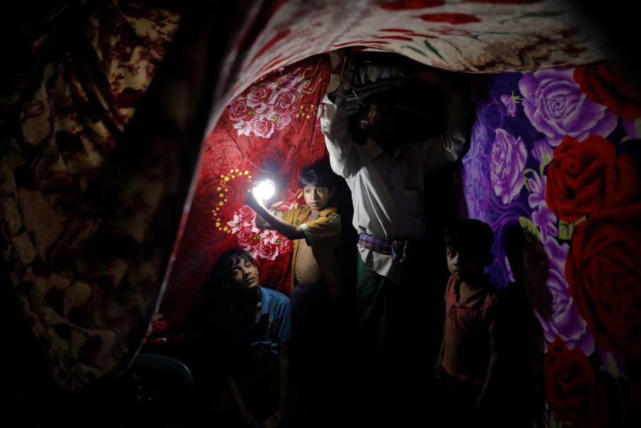 A refugee tent is decorated by colourful blankets for the wedding ceremony of Rohingya refugees Saddam Hussein, 23, and Shofika Begum, 18, at the Kutupalong camp near Cox's Bazar, Bangladesh, December 11, 2017. The newly wed couple, both from the village of Foyra Bazar in Maungdaw township that was burnt by the Myanmar military, fled with their families and other Rohingya some three months ago, Saddam Hussein said. They knew each other from before escaping from Myanmar and were planning to get married but managed to do so only now, as refugees living in the overcrowded Kutupalong refugee camp. Reuters Photo/Damir Sagolj   .