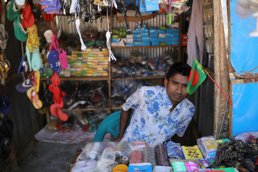 Saddam Hussein, 23, works at his family's shop at the Kutupalong refugee camp near Cox's Bazar, Bangladesh, December 16, 2017. The newly wed couple, both from the village of Foyra Bazar in Maungdaw township that was burnt by the Myanmar military, fled with their families and other Rohingya some three months ago, Saddam Hussein said. They knew each other from before escaping from Myanmar and were planning to get married but managed to do so only now, as refugees living in the overcrowded Kutupalong refugee camp. Reuters Photo/Damir Sagolj