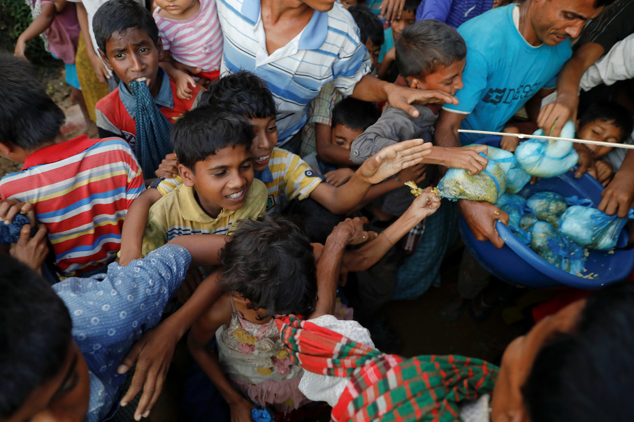 Refugee children scuffle over free meals given away during a wedding party for Rohingya refugees Saddam Hussein, 23, and Shofika Begum, 18, at the Kutupalong camp near Cox's Bazar, Bangladesh, December 11, 2017. The newly wed couple, both from the village of Foyra Bazar in Maungdaw township that was burnt by the Myanmar military, fled with their families and other Rohingya some three months ago, Saddam Hussein said. They knew each other from before escaping from Myanmar and were planning to get married but managed to do so only now, as refugees living in the overcrowded Kutupalong refugee camp. Reuters Photo/Damir Sagolj