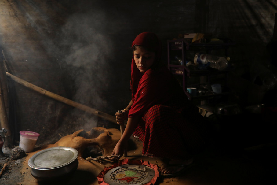 Shofika Begum, 18, who married Saddam Hussein, 23, both Rohingya refugees, cooks inside their temporary shelter at the Kutupalong refugee camp near Cox's Bazar, Bangladesh, December 16, 2017. The newly wed couple, both from the village of Foyra Bazar in Maungdaw township that was burnt by the Myanmar military, fled with their families and other Rohingya some three months ago, Saddam Hussein said. They knew each other from before escaping from Myanmar and were planning to get married but managed to do so only now, as refugees living in the overcrowded Kutupalong refugee camp. Reuters Photo/Damir Sagolj