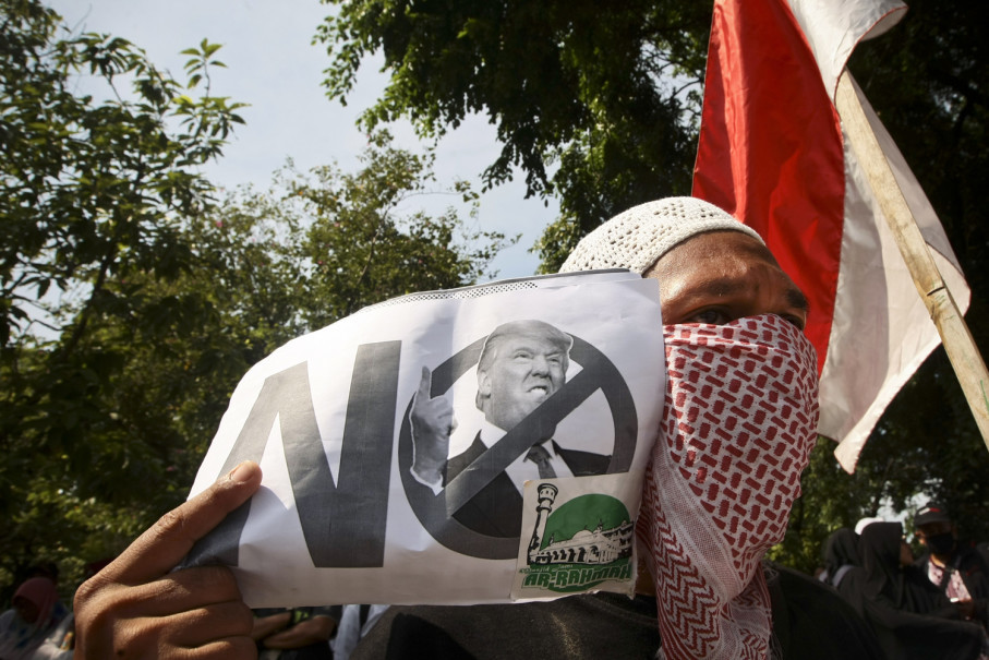 One of the many anti-Trump posters during the protest. (JG Photo/Yudha Baskoro)