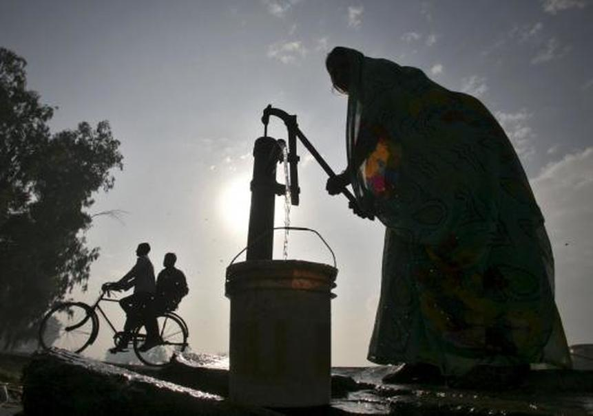 A woman pumps water from a well in Andhra Pradesh, India. (Reuters Photo/Munish Sharma)