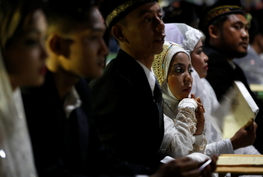 The mass wedding formed part of New Year's Eve celebrations. (Reuters Photo/Darren Whiteside)