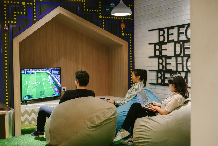 Playing games in EV Hive Uptown's workspace. (Photo courtesy of EV Hive)