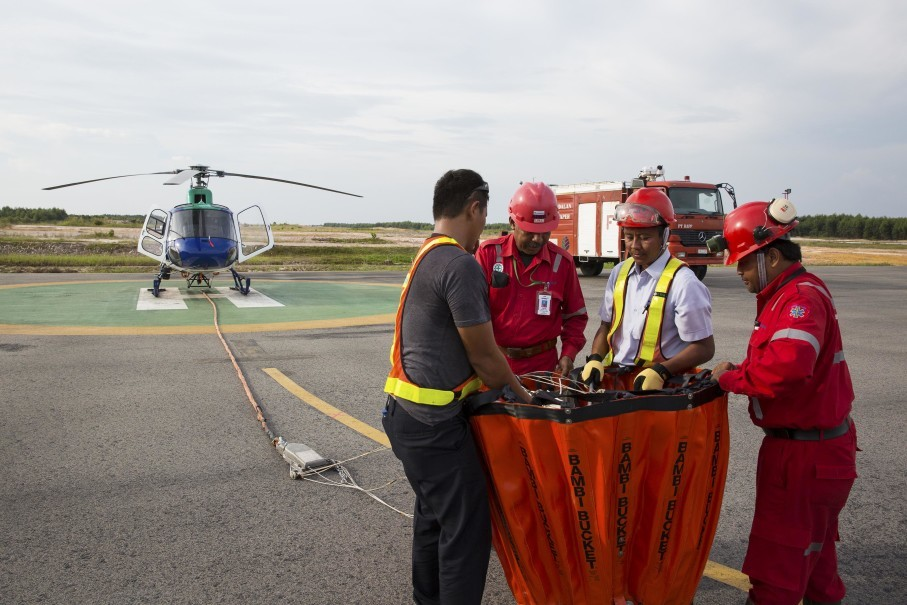 RAPP pays serious attention to preventing fires during this year's dry season. The company operates two helicopters and two water boats to support firefighters on the ground. (Photo courtesy of RAPP)