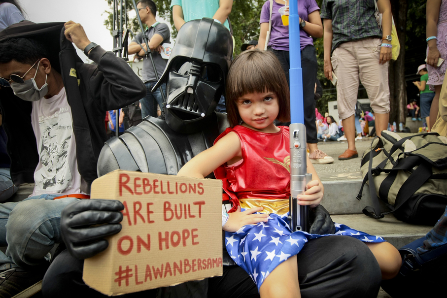 'Darth Vader' and 'Wonder Woman' participate in Women's March Jakarta 2018 on Saturday. (JG Photo/Yudha Baskoro)