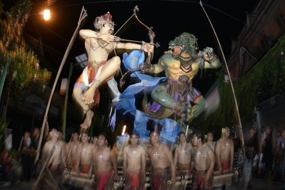 Men participate in a ngrupuk parade in Kuta, Bali, on Friday night. (Antara Photo/Fikri Yusuf)