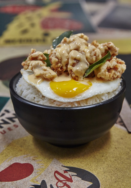Salted egg chicken with sunny side up at Eatlah. (Photo Courtesy of Eatlah)