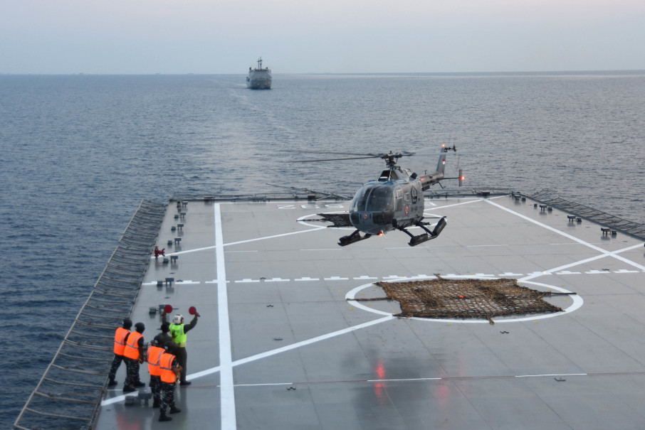 An Indonesian Navy Messerschmitt-Bölkow-Blohm Bo 105 twin-engine, multi-purpose helicopter landing on a ship in the Java Sea. (Antara Photo/M Risyal Hidayat)