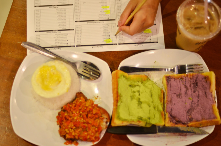 Nasi Ayam Penyet Pedesnya Ga Nyante (Rice With Chicken and Too Hot to Handle Chili Topping), toasts with matcha and taro spread and iced coffee with palm sugar at Warunk Upnormal. (JG Photo/Cahya Nugraha)
