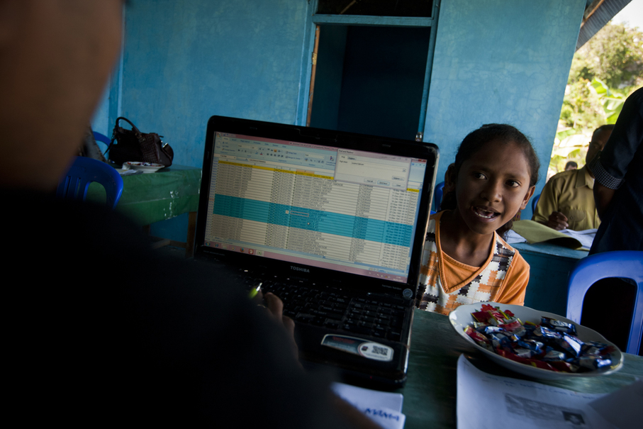 Mirna finally registering for her birth certificate thanks to a new government initiative that travels to remote areas in the province. (JG Photo / Yudha Baskoro)
