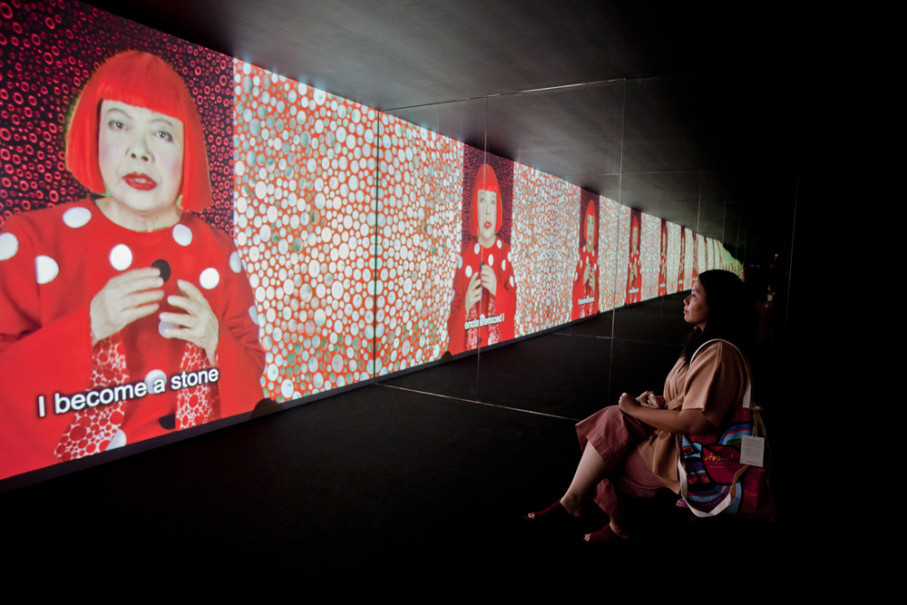 A visitor listens to Yayoi Kusama singing 'Song of a Manhattan Suicide Addict' at Museum MACAN in Jakarta on Monday (07/05). (JG Photo/Yudha Baskoro)