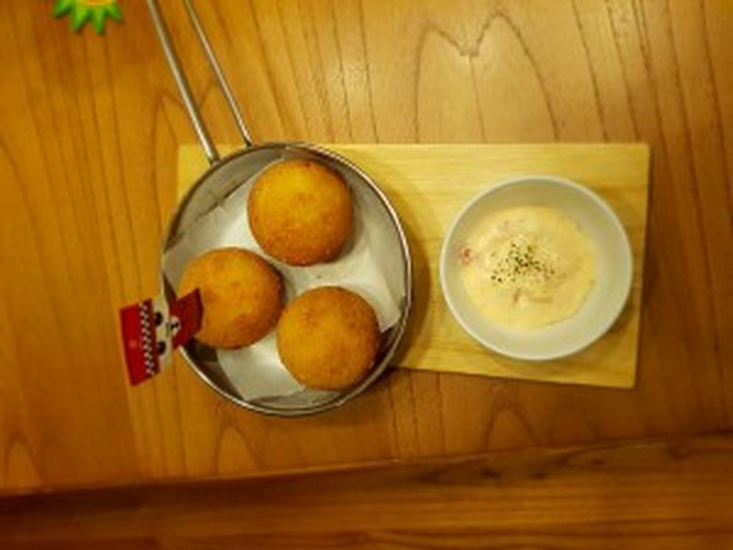 Pancious's newest appetizer, macaroni-and-cheese balls. (Photo courtesy of Narayana Kanna Joe)