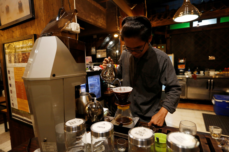 A barista brews locally gown coffee at Jack Runner Roastery and cafe. (Reuters Photo/Willy Kurniawan)