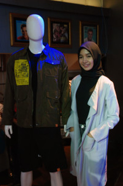 Dita Sri Lestari poses next to an outfit by Monstore. (Photo courtesy of Bekraf)