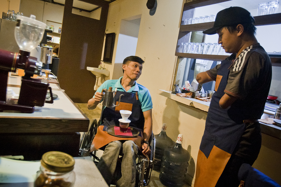 Eko and his friend Ade learning to use a Hario V60 coffee dripper at Cupable Café in Yogyakarta. Eko says he can brew at least 15 cups of coffee per day. (JG Photo/Yudha Baskoro)