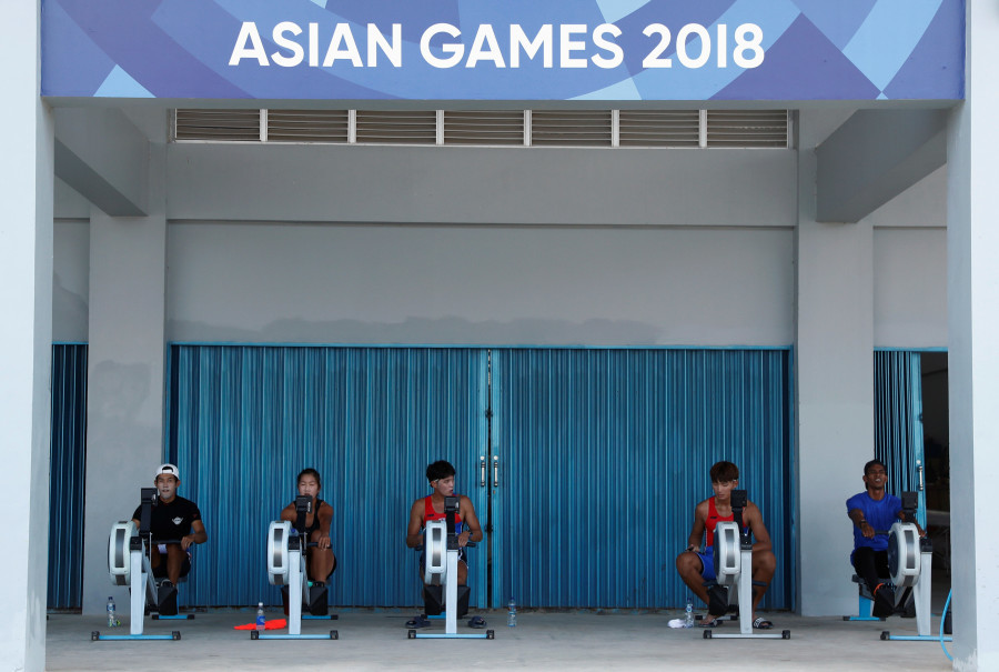 Members of the South Korean contingent train at the Jakabaring Rowing and Canoeing Center in preparation for the Asian Games. (Reuters Photo/Edgar Su)