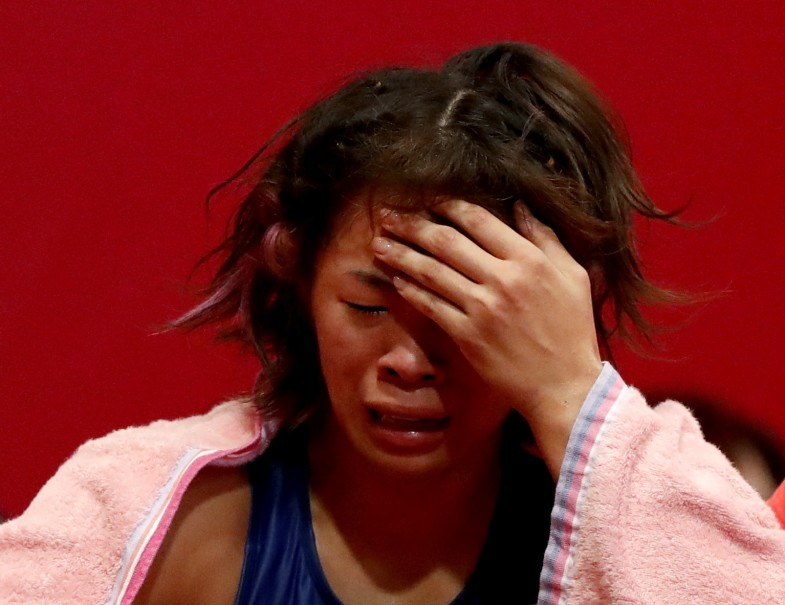 Risako Kawai of Japan reacts after loosing her fight. (Reuters Photo/Issei Kato)