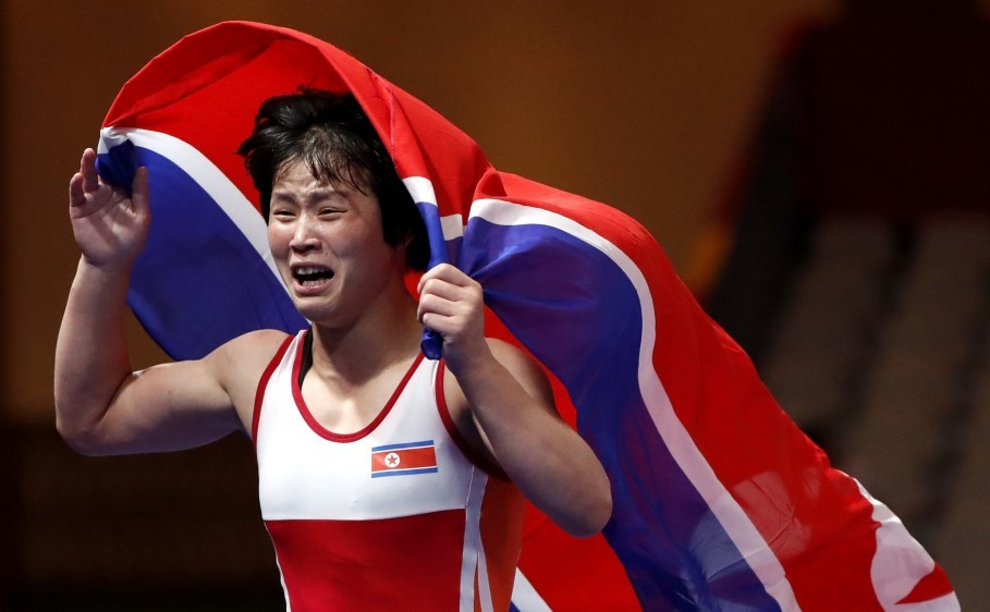 North Korean wrestler Pak Yong Mi celebrates after winning gold medal women's freestyle in the weight class up to 53 kilograms. (Reuters Photo/Issei Kato)