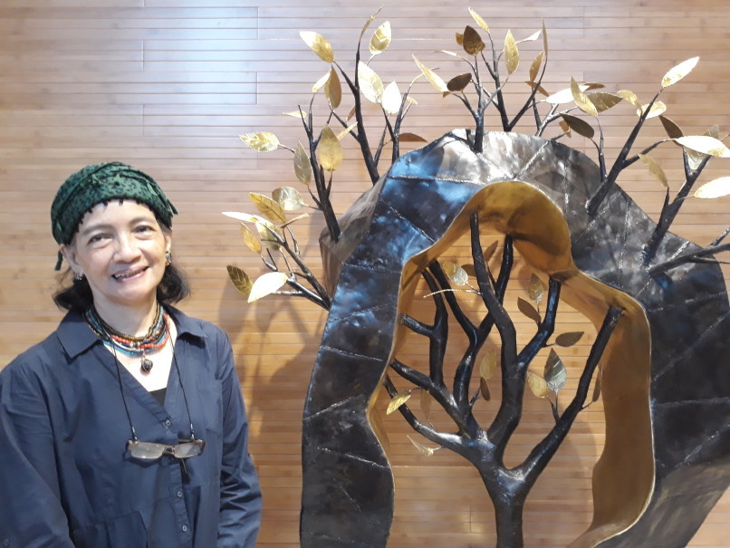 Vegan artist Yani Mariani Sastranegara with her 'Bait Bait Daun' ('Lyrics of the Leaves') sculpture. (JG Photo/Joy Muchtar)