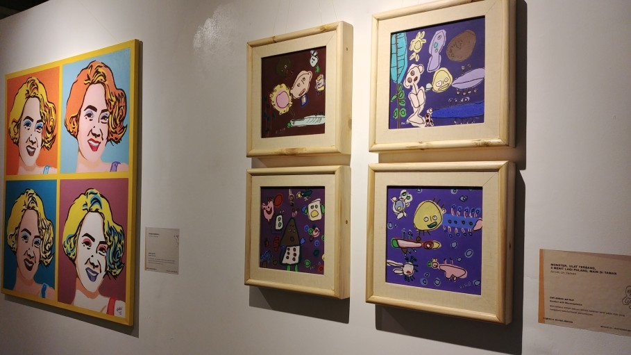 Taufan's 'Andien Warhol,' left, and Dini's monsters, caterpillars and scenes from a park. (JG Photo/Dhania Sarahtika)