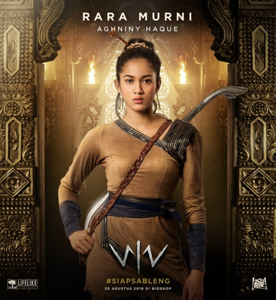 Rara Murni's songket outfit and mandau-like dagger. (Photo courtesy of Lifelike Pictures)